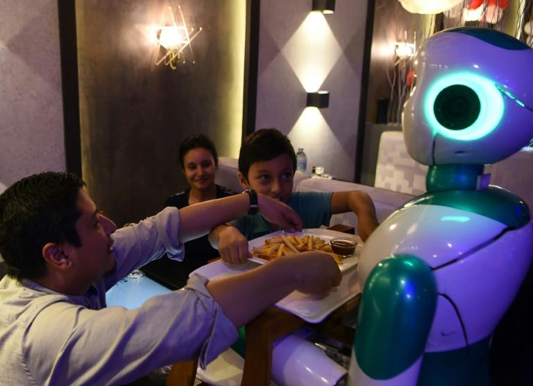 This humanoid robot named Ginger is one of three locally-built machines to serve customers at a restaurant in the capital of impoverished Nepal