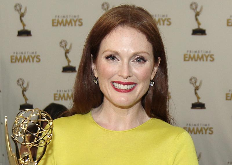 """FILE - In this Sept. 23, 2012 file photo, Actress Julianne Moore, winner Outstanding Lead Actress In A Miniseries or Movie for """"Game Change"""", poses backstage at the 64th Primetime Emmy Awards at the Nokia Theatre in Los Angeles.  Approximately $127,000 worth of jewelry has been stolen from Moore's New York City brownstone. Police said Thursday, Oct. 4 ,2012,  that a necklace, bracelets and watches, some by Cartier, were reported missing. They say the robbery occurred at the home in Manhattan's West Village sometime between June 6 and Aug. 28. (Photo by Matt Sayles/Invision/AP)"""