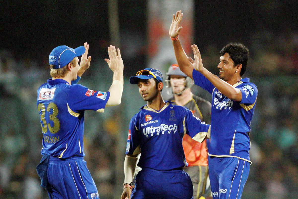 Siddarth Trivedi is congratulated by Shane watson on taking the wicket of Cameron White during the Eliminator match of the 2013 Pepsi Indian Premier League between the Rajasthan Royals and the Sunrisers Hyderabad held at the Feroz Shah Kotla Stadium, Delhi on the 22nd May 2013. (BCCI)