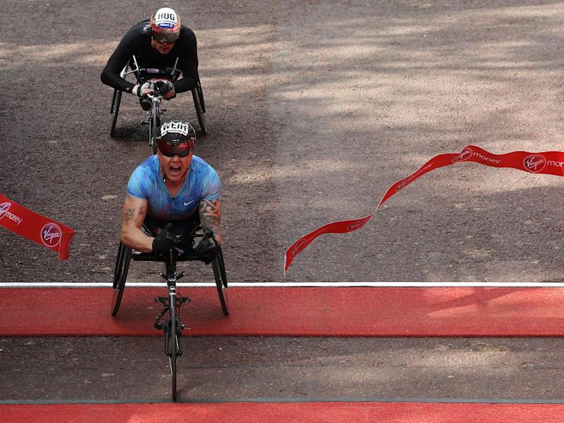 Weir crosses the line in the men's wheelchair race (Getty)