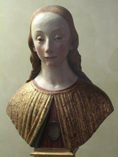 Statue bust of a woman's head and shoulders.