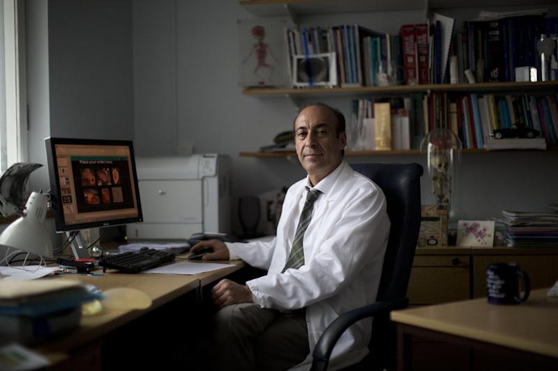 "Professor Alexander Seifalian poses for a portrait in his office at his research facility in the Royal Free Hospital in London, Monday, March 31, 2014. In the north London hospital, scientists are growing noses, ears and blood vessels in the laboratory in a bold attempt to make body parts using stem cells. It is among several labs around the world, including in the U.S., that are working on the futuristic idea of growing custom-made organs in the lab. While only a handful of patients have received the British lab-made organs so far— including tear ducts, blood vessels and windpipes — researchers hope they will soon be able to transplant more types of body parts into patients, including what would be the world's first nose made partly from stem cells. ""It's like making a cake,"" said Alexander Seifalian at University College London, the scientist leading the effort. ""We just use a different kind of oven."" (AP Photo/Matt Dunham)"