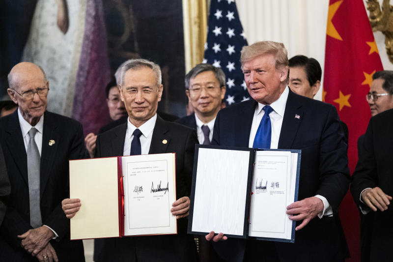 WASHINGTON, DC - JANUARY 15 : President Donald J. Trump signs a trade agreement with Chinese Vice Premier of the People's Republic of China, Liu He in the East Room at the White House on Wednesday, Jan 15, 2020 in Washington, DC. (Photo by Jabin Botsford/The Washington Post via Getty Images)