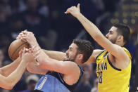 Cleveland Cavaliers' Kevin Love, left, and Indiana Pacers' Goga Bitadze battle or a rebound in the first half of an NBA basketball game, Saturday, Feb. 29, 2020, in Cleveland. (AP Photo/Tony Dejak)