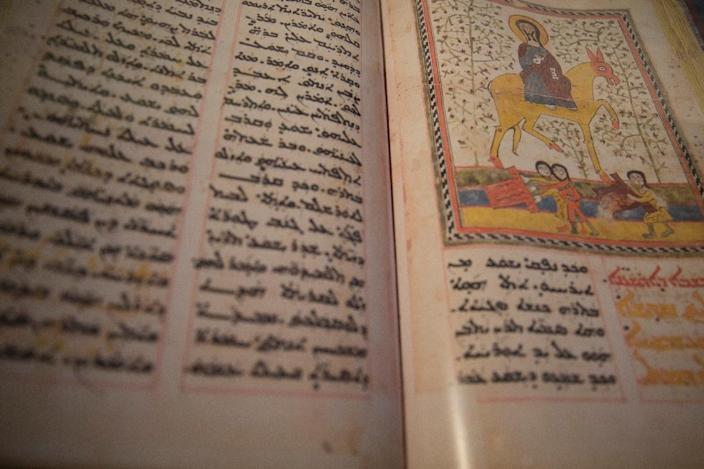 A view of an ancient text on display at the National Archives in Paris on May 22, 2015 (AFP Photo/Kenzo Tribouillard)