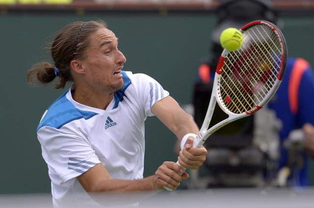 Alexandr Dolgopolov, of Ukraine, hits to Milos Raonic, of Canada, during a quarterfinal match at the BNP Paribas Open tennis tournament on Thursday, March 13, 2014, in Indian Wells, Calif. (AP Photo/Mark J. Terrill)