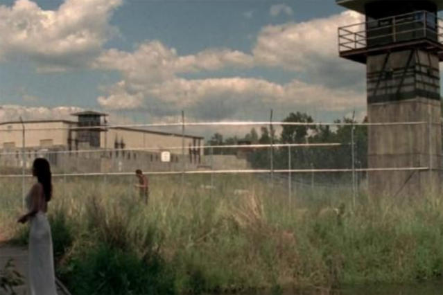 <p>After being cleared of walkers, the prison acts as a stronghold for Rick and crew. They even plant vegetables! But it soon becomes a death trap — Lori dies in childbirth here, and then the Governor invades. The prison scenes were filmed at Raleigh Studios.<br>Address: 600 Chestlehurst Rd Senoia, GA 30276<br>(Photo: AMC) </p>