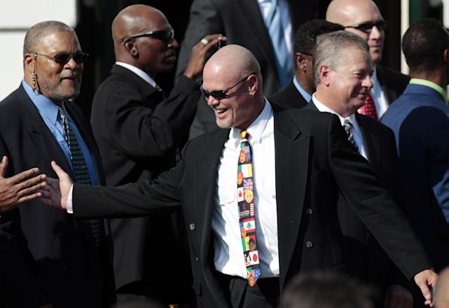 FILE - In this Oct. 7, 2011, file photo, Former Bears quarterback Jim McMahon, celebrates on stage after taking part in a ceremony honoring the 1985 Super Bowl XX Champions Chicago Bears football team, hosted by President Barack Obama, on the South Lawn of the White House in Washington. McMahon is one of more than 4,500 former players that have filed suit, some accusing the NFL football league of fraud for its handling of concussions. A federal judge on Tuesday, Jan. 14, 2014, denied preliminary approval of a $765 million settlement of NFL concussion claims, fearing it may not be enough to cover 20,000 retired players. (AP Photo/Pablo Martinez Monsivais, File)