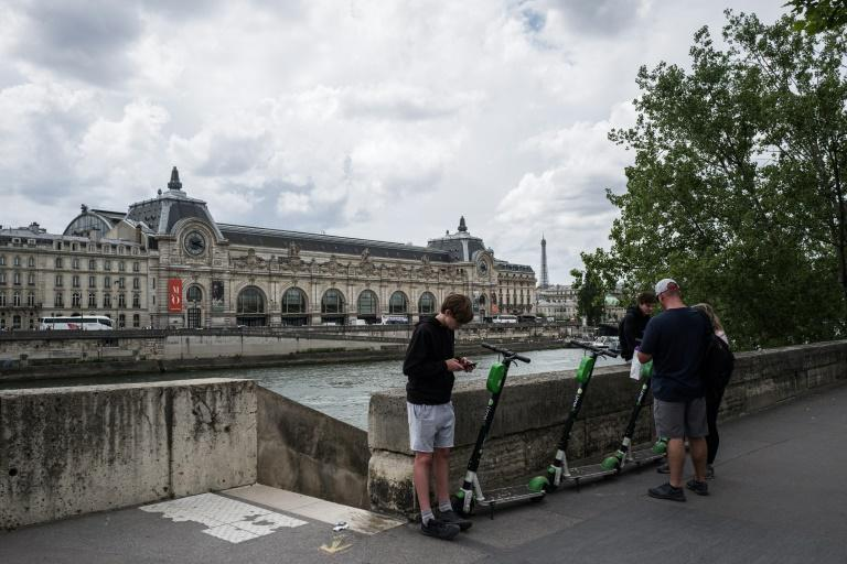 The surge of electric scooters in Paris and other French cities is fuelling questions about their true environmental impact (AFP Photo/Philippe LOPEZ)