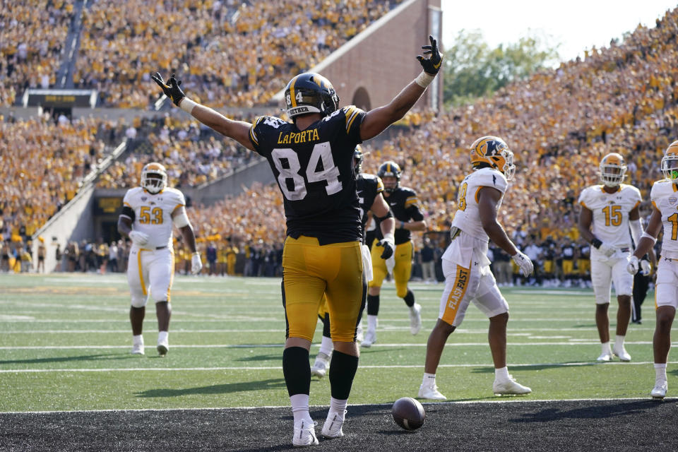 Iowa tight end Sam LaPorta (84) celebrates after catching a 5-yard touchdown pass during the first half of an NCAA college football game against Kent State, Saturday, Sept. 18, 2021, in Iowa City, Iowa. (AP Photo/Charlie Neibergall)