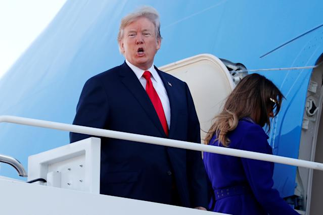 <p>President Donald Trump shouts to reporters as he and and first lady Melania Trump board Air Force One for travel to Hawaii, on his way to an extended trip to five countries in Asia, from Joint Base Andrews, Md., Nov. 3, 2017. (Photo: Jonathan Ernst/Reuters) </p>