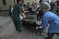 Injured school students are transported to a hospital after a bomb explosion near a school in west of Kabul, Afghanistan, Saturday, May 8, 2021. A bomb exploded near a school in west Kabul on Saturday, killing several people, many them young students, an Afghan government spokesmen said. (AP Photo/Rahmat Gul)