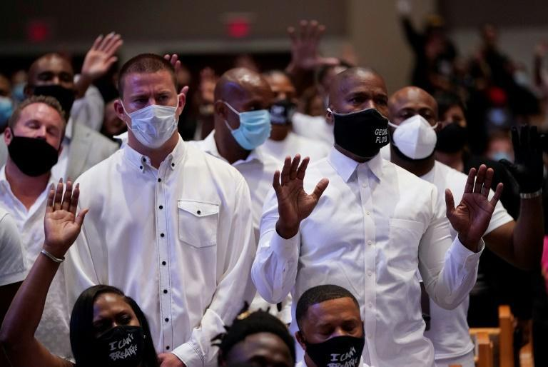 Actors Channing Tatum (L) and Jamie Foxx (R) take part in the funeral of George Floyd on June 9, 2020, at The Fountain of Praise church in Houston, Texas (AFP Photo/David J. Phillip)