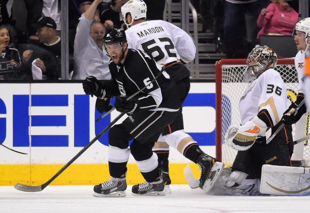 Los Angeles Kings defenseman Jake Muzzin, left, celebrates his goal as Anaheim Ducks left wing Patrick Maroon, center, and goalie John Gibson look on during the first period in Game 6 of an NHL hockey second-round Stanley Cup playoff series, Wednesday, May 14, 2014, in Los Angeles. (AP Photo)
