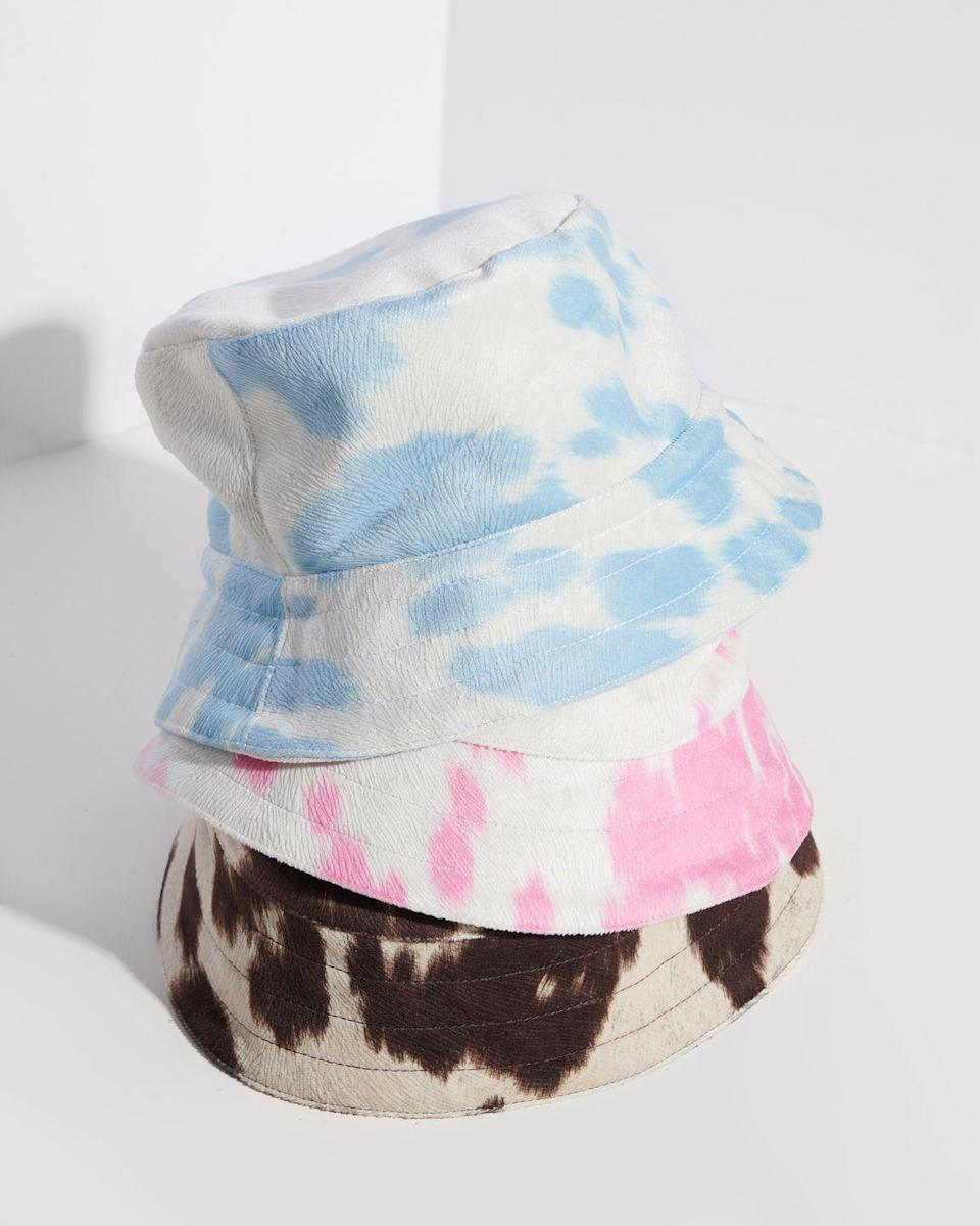 """<p><strong>Who: </strong>MAMAG/group and PHLEMUNS</p><p><strong>What: </strong>Bucket hat collaboration</p><p><strong>Where:</strong> Available online at Phlemuns.com</p><p><strong>Why: </strong>Genderless label PHLEMUNS based out of Los Angeles has teamed up with their parent company MAMAG/group, a holding company focused on representation and equitable opportunity across multiple sectors and industries.Their first product collaboration resulted in these timeless bucket hats made in cow print, coming in three unique colors and seamlessly meshing with the elevated, accessible and cool designer James Flemons has become known for at PHLEMUNS. Each hat is handmade and 20% of the proceeds from profits go back to Homeless Health Care Los Angeles, an organization focused on supporting the homeless population and specifically the residents of Skid Row.</p><p><a class=""""link rapid-noclick-resp"""" href=""""https://phlemuns.com/collections/accessories"""" rel=""""nofollow noopener"""" target=""""_blank"""" data-ylk=""""slk:SHOP NOW"""">SHOP NOW</a></p>"""