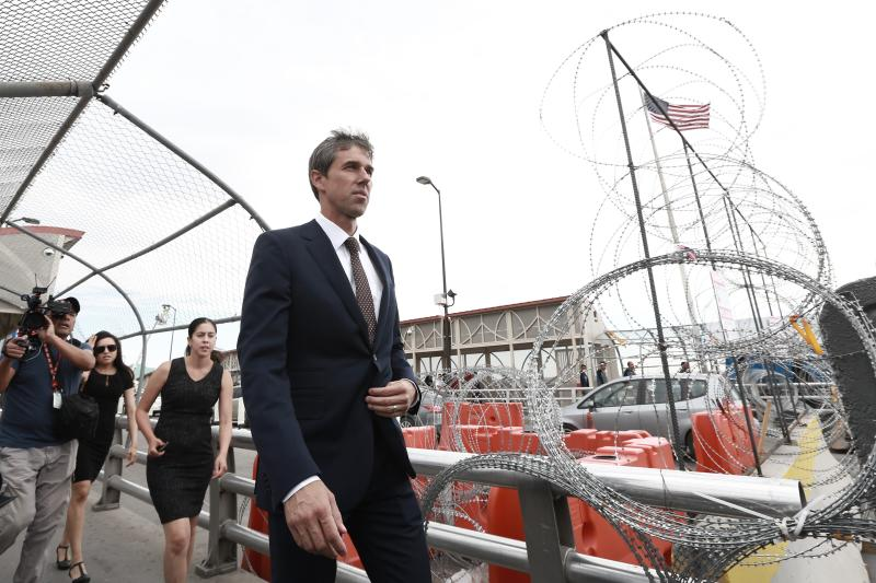 Democratic presidential candidate Beto O'Rourke walks on an international bridge to cross into Ciudad Juarez, Mexico, Thursday, Aug. 8, 2019. O'Rourke has crossed the border into Mexico for the funeral of one of the 22 people killed in a mass shooting at a Walmart in El Paso, Texas.  (AP Photo/Christian Chavez)
