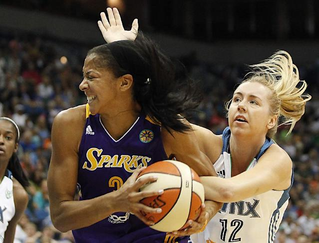FILE - In this Sept. 4, 2013, file photo, Los Angeles Sparks forward Candace Parker (3) is fouled by Minnesota Lynx forward Rachel Jarry (12) in the first half of a WNBA basketball game in Minneapolis. Parker has won the WNBA MVP, said a person familiar with the situation. She will receive the award Thursday night, Sept. 18, 2013, in Los Angeles, before the Sparks play the Phoenix Mercury in the opener of their Western Conference playoff series, the person said. The person spoke to The Associated Press on condition of anonymity because no official announcement has been made. (AP Photo/Stacy Bengs, File)
