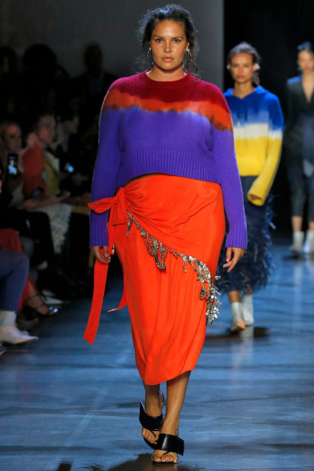 <p>For Prabal Gurung's diverse New York Fashion Week show, which featured models from over 35 countries, the designer continues to make his designs for all. Here, plus-size model Candice Huffine walks the show wearing a hand-dipped tie-dye knit sweater and red embellished sarong. (Photo: Getty Images) </p>