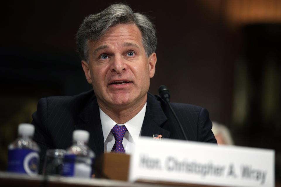 FBI Director Christopher Wray testified on Tuesday about his agency's ongoing efforts to bring Capitol rioters to justice. (Getty Images)
