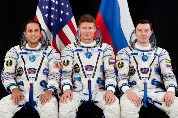 Attired in Russian Sokol launch and entry suits, Russian cosmonaut Gennady Padalka (center), Expedition 31 flight engineer and Expedition 32 commander; along with NASA astronaut Joe Acaba (left) and Russian cosmonaut Sergei Revin, both Expediti