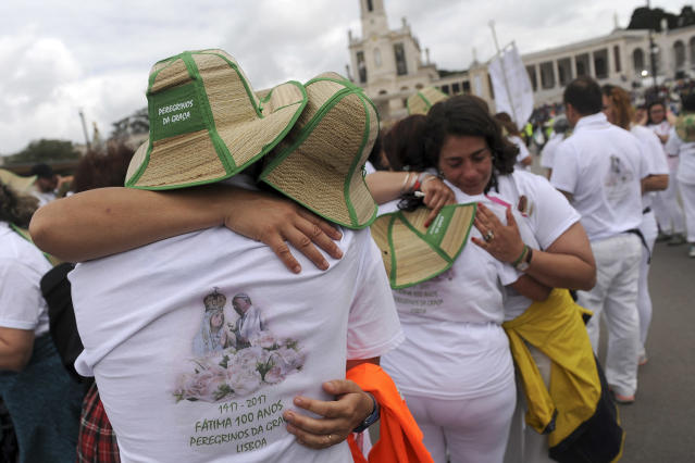 <p>A group of pilgrims from Lisbon embrace after their arrival at the Sanctuary of Our Lady of Fatima, May 12 2017, in Fatima, Portugal. Pope Francis will canonize on Saturday two poor, illiterate shepherd children whose visions of the Virgin Mary 100 years ago marked one of the most important events of the 20th-century Catholic Church. (Photo: Paulo Duarte/AP) </p>