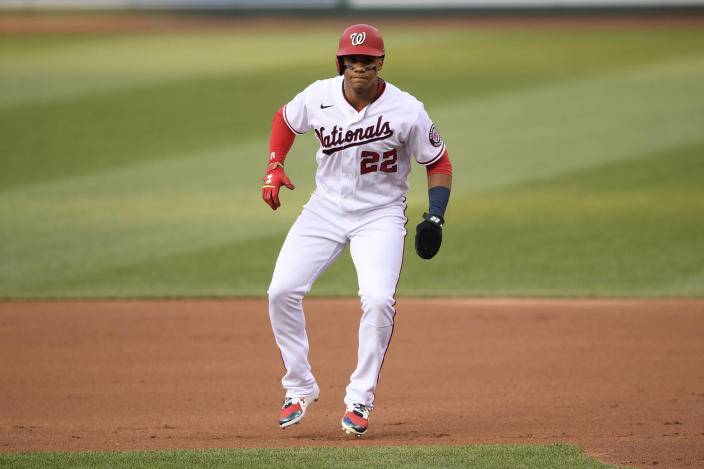 Washington Nationals' Juan Soto takes a lead from first base during the first inning of the team's baseball game against the Miami Marlins, Wednesday, July 21, 2021, in Washington. (AP Photo/Nick Wass)