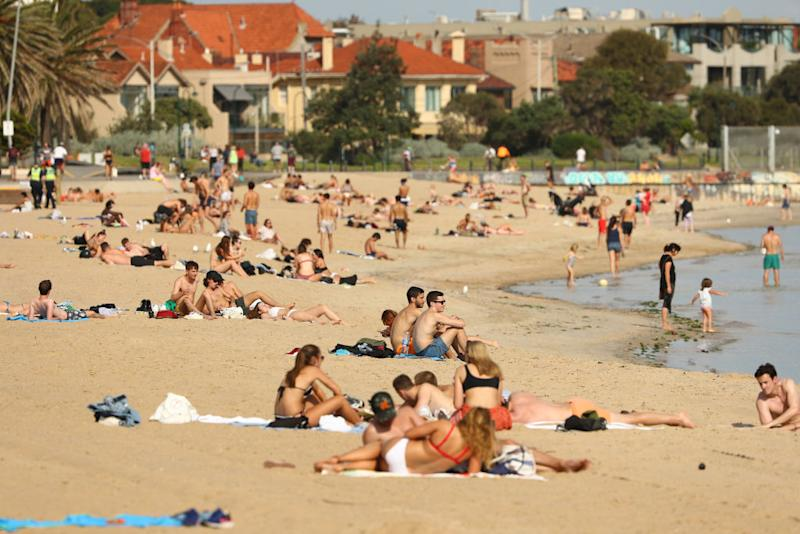 People are seen at St Kilda Beach in Melbourne, Australia.