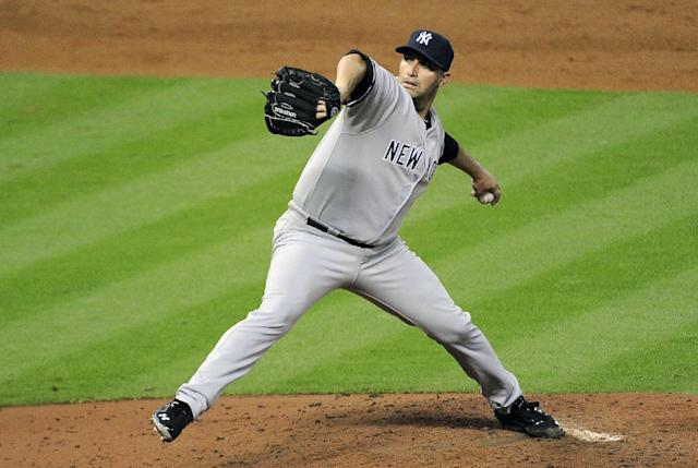 New York Yankees' Andy Pettitte delivers a pitch against the Houston Astros in the fifth inning of a baseball game Saturday, Sept. 28, 2013, in Houston. Pettitte is retiring after 18 seasons in the major leagues. (AP Photo/Pat Sullivan)