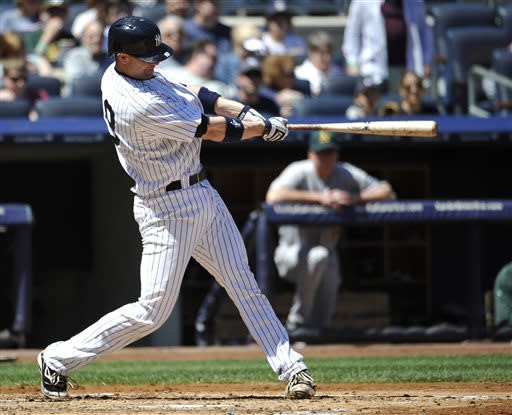 New York Yankees' Chris Stewart hits a solo home run off of Oakland Athletics starting pitcher Bartolo Colon in the third inning of a baseball game at Yankee Stadium on Saturday, May 4, 2013 in New York. (AP Photo/Kathy Kmonicek)