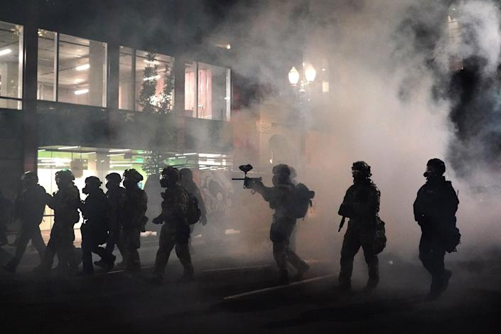 Law enforcement fired tear gas at demonstrators in Portland, Oregon, among many cities that saw the use of tear gas over several months of protests in 2020. (Getty Images)