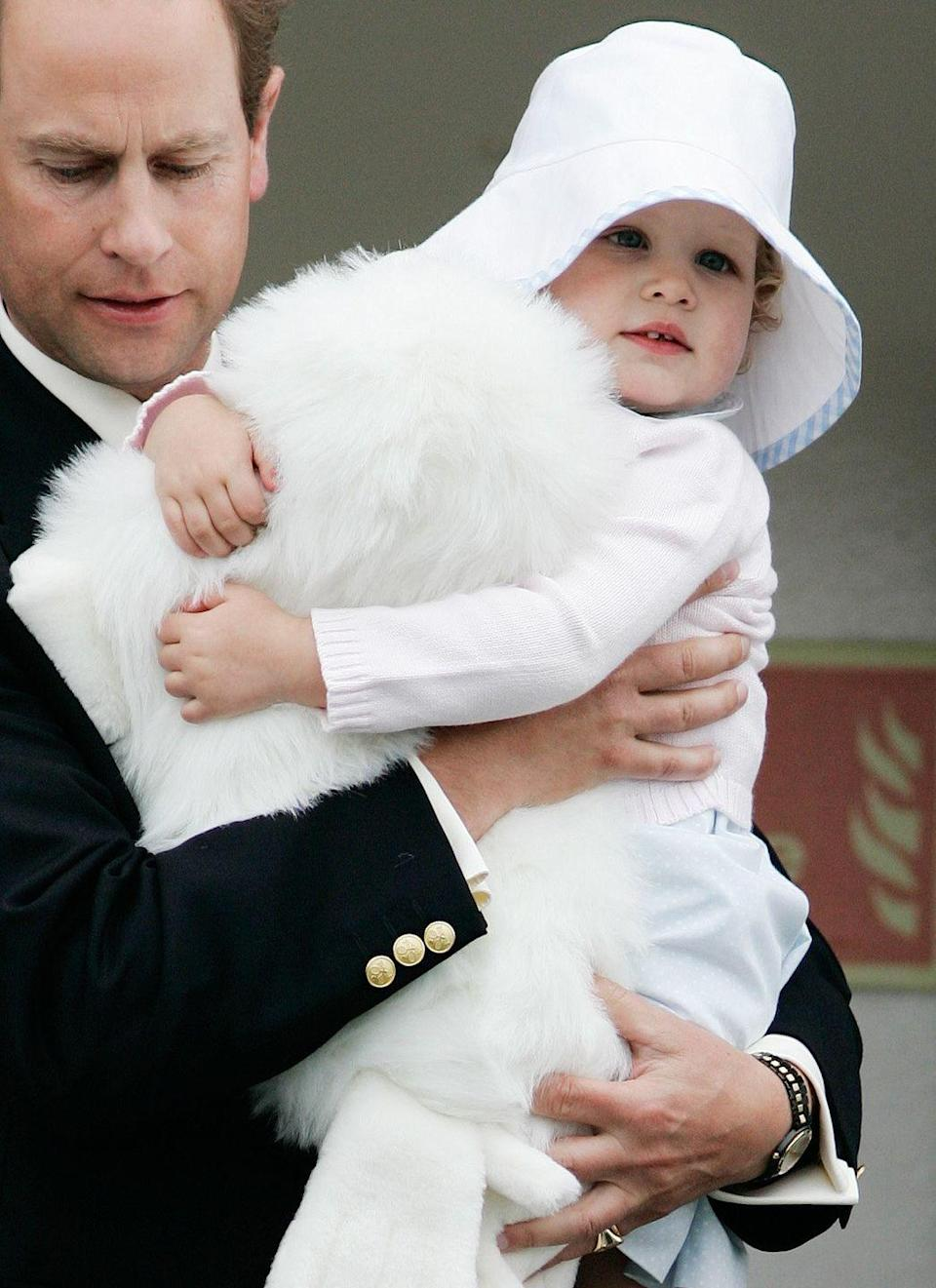 """<p>Lady Louise, 2, hugs a fluffy pillow while arriving in Scotland with her father, Prince Edward. In 2016, Louise's mother, Sophie, the Countess of Wessex, told the BBC that it took some time for Louise to realize that her grandmother was the queen. """"Well, for Louise, actually, it was much more of a shock to the system. It was only when she was coming home from school and saying, 'Mummy, people keep on telling me that grandma is the queen.' And I asked her, 'Yes, how does that make you feel? And she said, 'I don't understand'"""" (via <em><a href=""""http://people.com/royals/lady-louise-windsor-didnt-realize-her-grandmother-is-the-queen/"""" rel=""""nofollow noopener"""" target=""""_blank"""" data-ylk=""""slk:PEOPLE"""" class=""""link rapid-noclick-resp"""">PEOPLE</a></em>).</p>"""