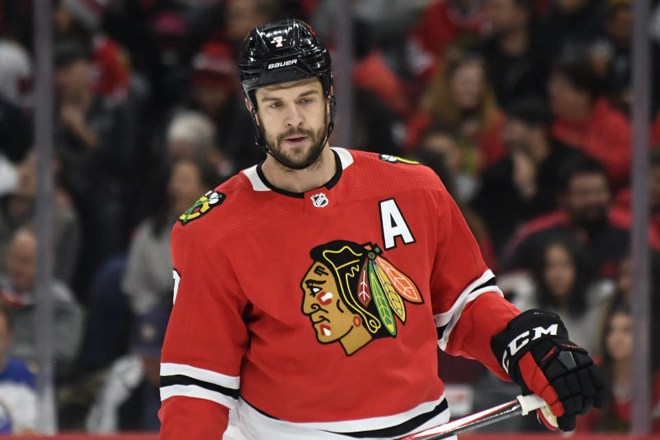 FILE - Chicago Blackhawks defenseman Brent Seabrook plays against the Buffalo Sabres during the first period of an NHL hockey game in Chicago, in this Sunday, Nov. 17, 2019, file photo. Longtime Chicago Blackhawks defenseman and three-time Stanley Cup winner Brent Seabrook announced Friday, March 5, 2021, he's unable to continue playing hockey because of injury. (AP Photo/David Banks, File)