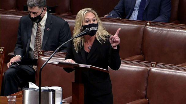 PHOTO: Rep. Marjorie Taylor Greene speaks during debate ahead of the House vote on impeachment against President Donald Trump, while wearing a mask that reads, 'censored,' in the House Chamber of the U.S. Capitol in Washington, D.C., Jan. 13, 2021. (House TV via Reuters)
