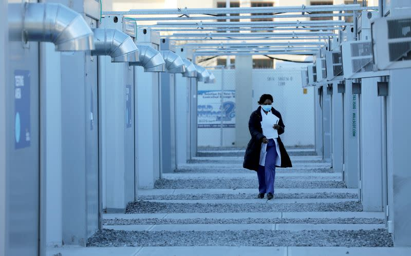 A person walk between pods at a mass vaccination site for the coronavirus disease (COVID-19) at Brooklyn Army Terminal in New York