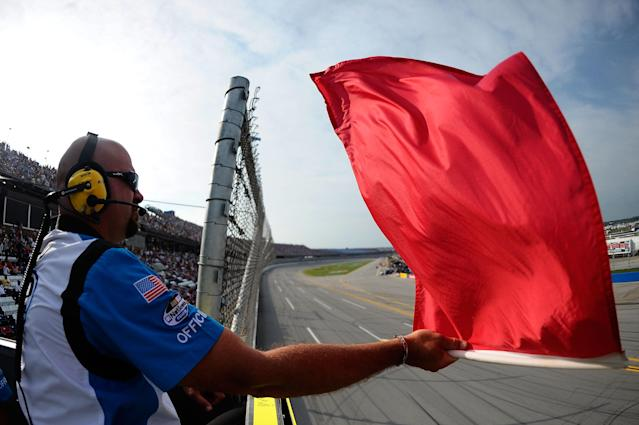 TALLADEGA, AL - MAY 05: An official in the flagstand waves the red flag during the NASCAR Nationwide Series Aaron's 312 at Talladega Superspeedway on May 5, 2012 in Talladega, Alabama. (Photo by Jared C. Tilton/Getty Images)