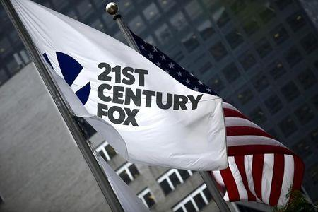 The flag of the Twenty-First Century Fox Inc is seen waving at the company headquarters in the Manhattan borough in New York