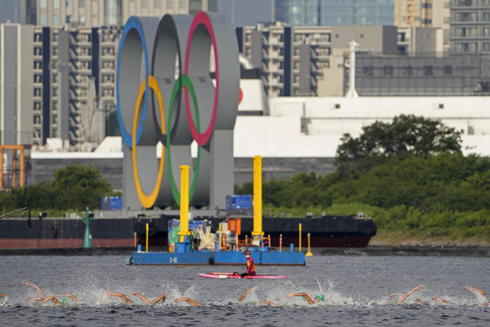 <p>Athletes compete in the swim leg of the men's individual triathlon at the 2020 Summer Olympics, Monday, July 26, 2021, in Tokyo, Japan. (AP Photo/Jae C. Hong)</p>
