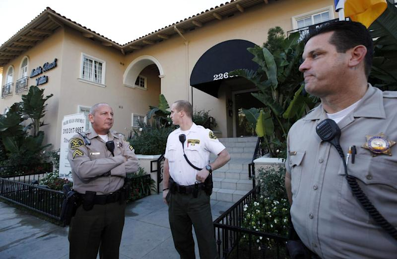 Los Angeles County Sheriff's officers stand outside an apartment building where Scott Sterling,  the son of the  Los Angeles Clippers owner Donald Sterling, lived in Malibu on Wednesday, Jan.2,2012. Scott Sterling was found dead of an apparent drug overdose at his Malibu home, authorities said Wednesday. (AP Photo/Nick Ut)