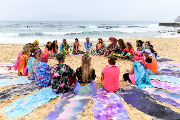 Harry and Meghan join members of OneWave, a local surfing community group who raise awareness for mental health and wellbeing, at Bondi Beach.