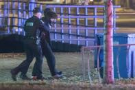 Police officers detain a man in an area where multiple people were stabbed near the Parliament Hill area of Quebec City