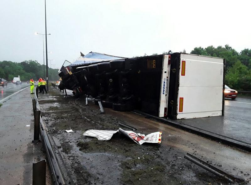 The aftermath of the lorry crash between Junction 7 and 8 of the M25 (Picture: SWNS)