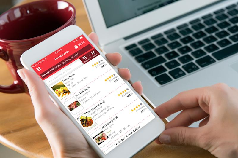 A customer uses Grubhub's mobile app.