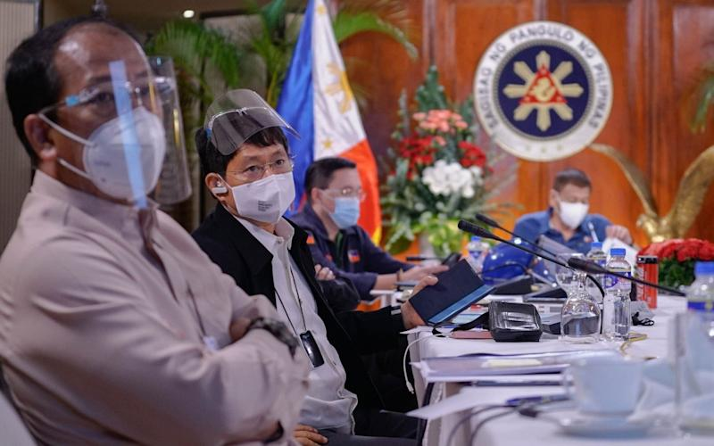 Philippine Interior Minister Eduardo Ano (second from the left) attending an Inter-Agency Task Force on the Emerging Infectious Diseases - King Rodriguez / PRESIDENTIAL PHOTO DIVISION / AFP