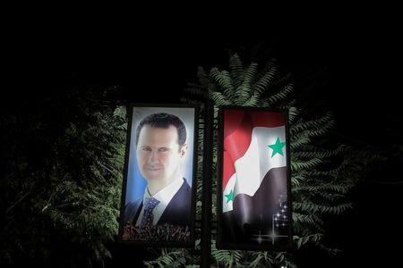 FILE PHOTO: A picture of Syrian President Bashar al-Assad is seen at a train station in Damascus, Syria, September 12, 2018. Picture taken September 12, 2018. REUTERS/Marko Djurica/File Photo