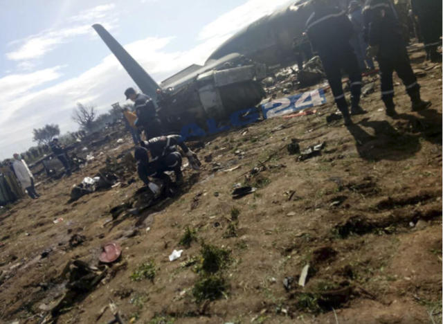 <p>This image dated on April 11, 2018, and posted by Algerian news agency ALG24, shows firefighters and soldiers at the scene of a fatal military plane crash near Boufarik military base near the Algerian capital, Algiers. (Photo: ALG24 via AP) </p>