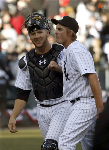 Chicago White Sox catcher Tyler Flowers, left, celebrates with relief pitcher Addison Reed the White Sox's 1-0 opening day win over the Kansas City Royals after baseball game Monday, April 1, 2013, in Chicago. (AP Photo/Charles Rex Arbogast)