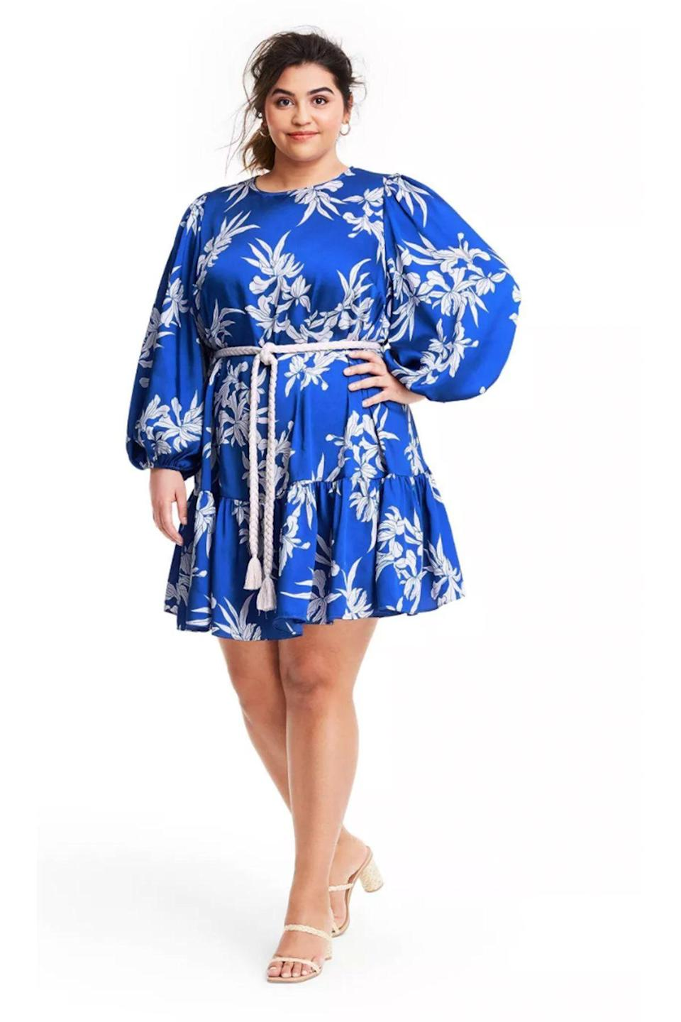 """<p><strong>ALEXIS for Target</strong></p><p>target.com</p><p><strong>$40.00</strong></p><p><a href=""""https://www.target.com/p/floral-long-sleeve-rope-belt-tiered-dress-alexis-for-target-blue/-/A-82020669"""" rel=""""nofollow noopener"""" target=""""_blank"""" data-ylk=""""slk:Shop Now"""" class=""""link rapid-noclick-resp"""">Shop Now</a></p>"""