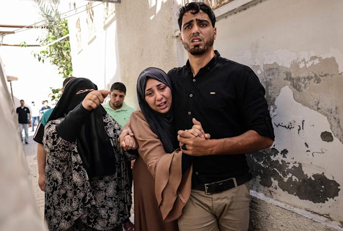 Image: Relatives mourn the death of two members of the Palestinian Alrantisi family, killed in an Israeli air strike, at their funeral in Rafah in the southern Gaza Strip, (Said Khatib / AFP - Getty Images)
