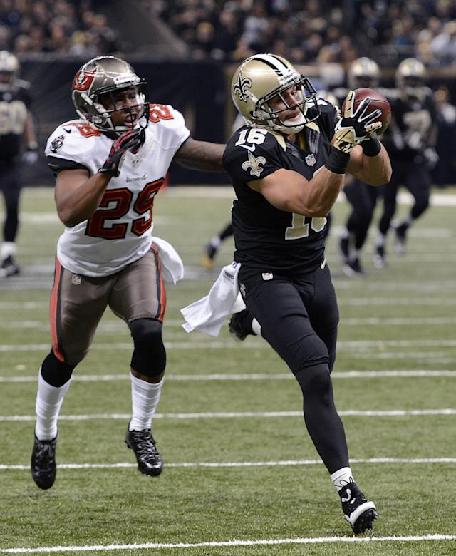 New Orleans Saints wide receiver Lance Moore (16) pulls in a touchdown reception in front of Tampa Bay Buccaneers cornerback Leonard Johnson (29) in the first half of an NFL football game, Sunday, Dec. 29, 2013, in New Orleans. (AP Photo/Bill Feig)