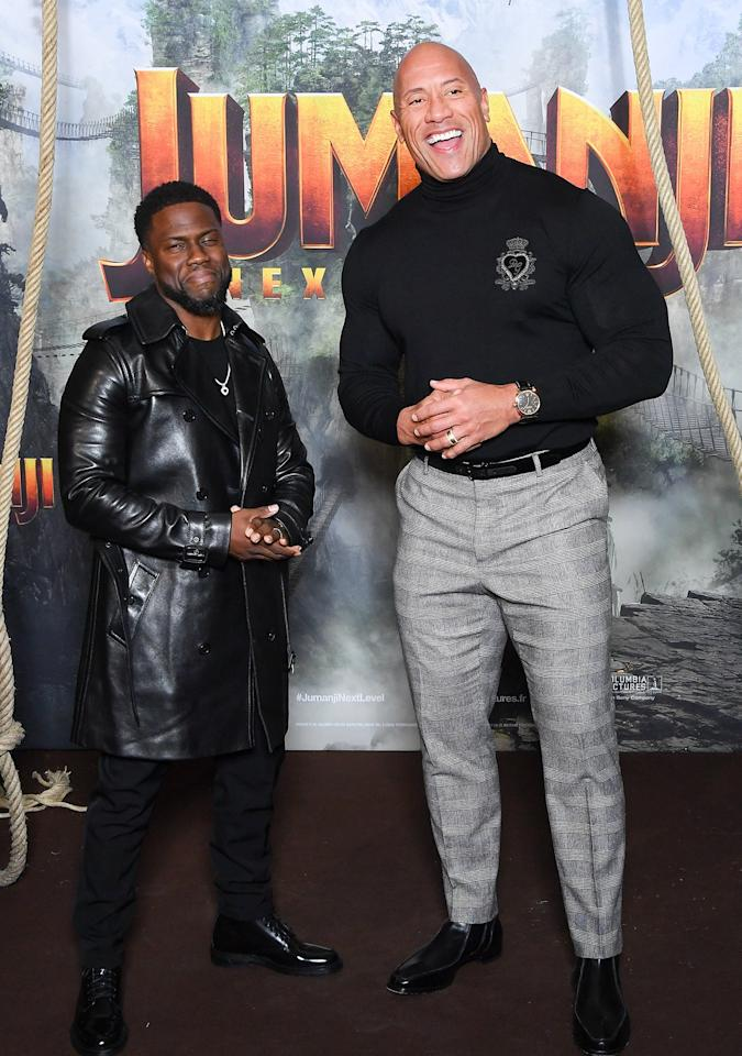 "Also at the <em>Jumanji</em> photo call, costars and good friends Kevin Hart and Dwayne ""The Rock"" Johnson."